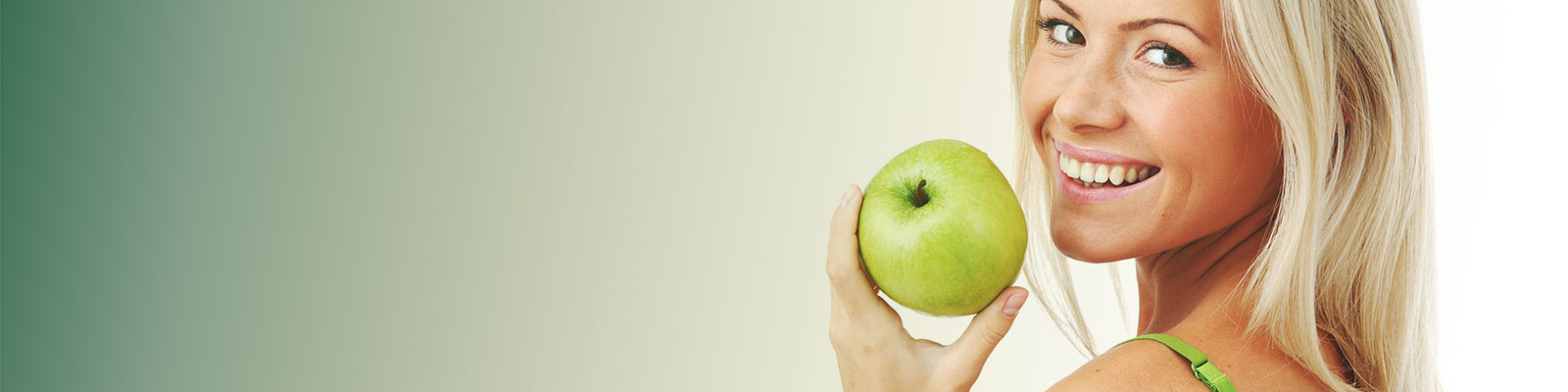 Woman eating an green apple