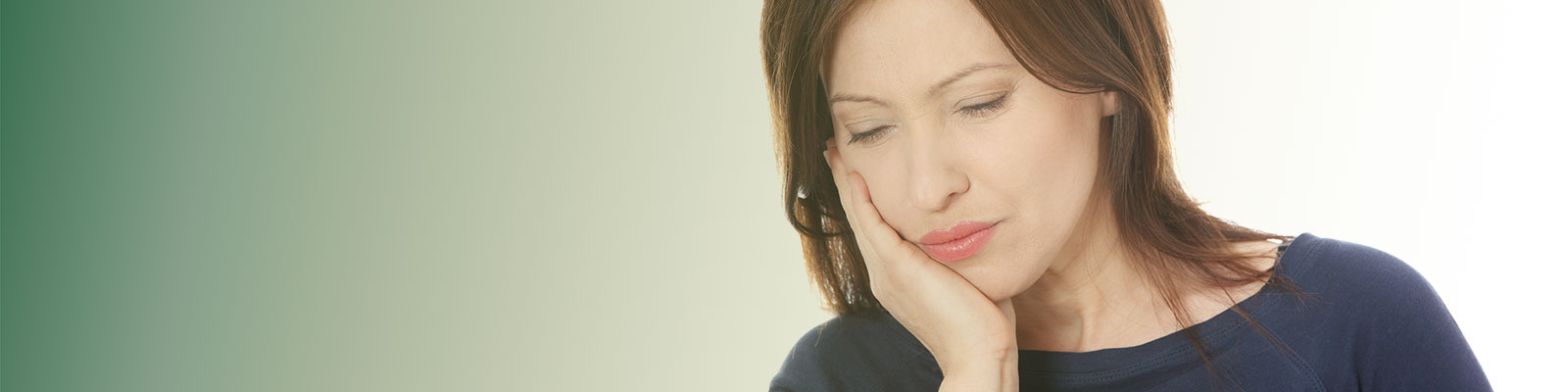 Woman having terrible toothache